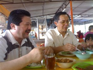 Uncle Syed (left- beside dad) telling us a joke while eating his Nasi Dagang