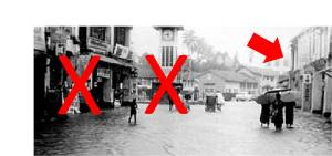 Those buildings with X had already been demoliished. The arrow shows the building to be demolished. [old photo in 1960s showing flooding in the area]